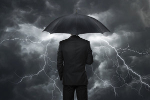 umbrella-businessman-protection-stormy-dark-insurance-100678044-primary.idge